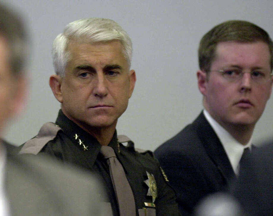 King County Sheriff Dave Reichert listens as Gary Ridgway pleads guilty to 48 counts of murder in the King County Courthouse in Seattle Wednesday, Nov. 5, 2003.  Reichart was one of the original dectectives on the case in the 1980s. Ridgway plead guilty in the Green River Killer serial murders case which began in 1982 and was the largest unsolved serial murder case in American history. Ridgway was to be sentenced to life in prison as part of a plea agreement.  (AP Photo/Elaine Thompson) Photo: ELAINE THOMPSON, P-I File Photos / AP POOL