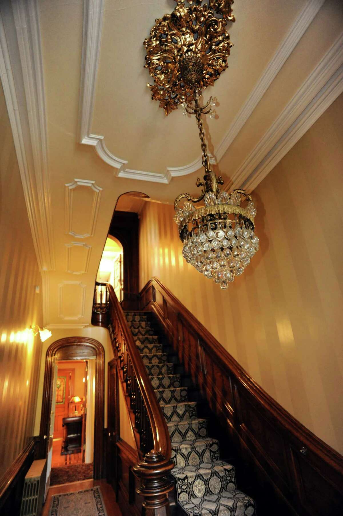 Built as a private home in 1862, the first and second floors of the brownstone were converted to office space in 1978. The entryway and staircase to the second floor on Tuesday, Oct. 15, 2013, at Bouchey Financial Group in Troy, N.Y. (Cindy Schultz / Times Union)