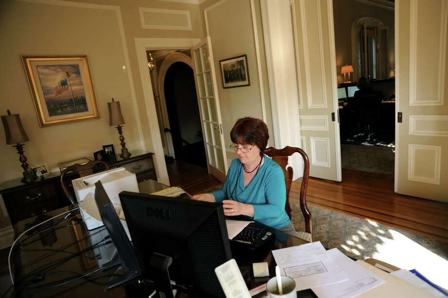 Sue Dawes, accounting specialist, works in her office on Tuesday, Oct. 15, 2013, at Bouchey Financial Group in Troy, N.Y. (Cindy Schultz / Times Union) Photo: Cindy Schultz / 00024231A