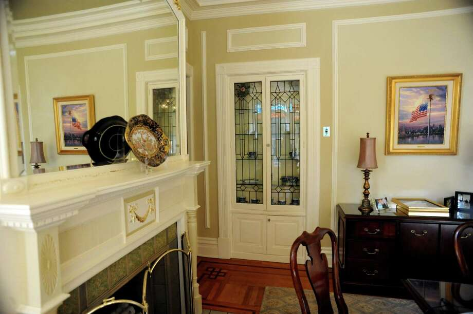Fireplace mantle and built-in cabinet in the office of Sue Dawes, accounting specialist, on Tuesday, Oct. 15, 2013, at Bouchey Financial Group in Troy, N.Y. (Cindy Schultz / Times Union) Photo: Cindy Schultz / 00024231A