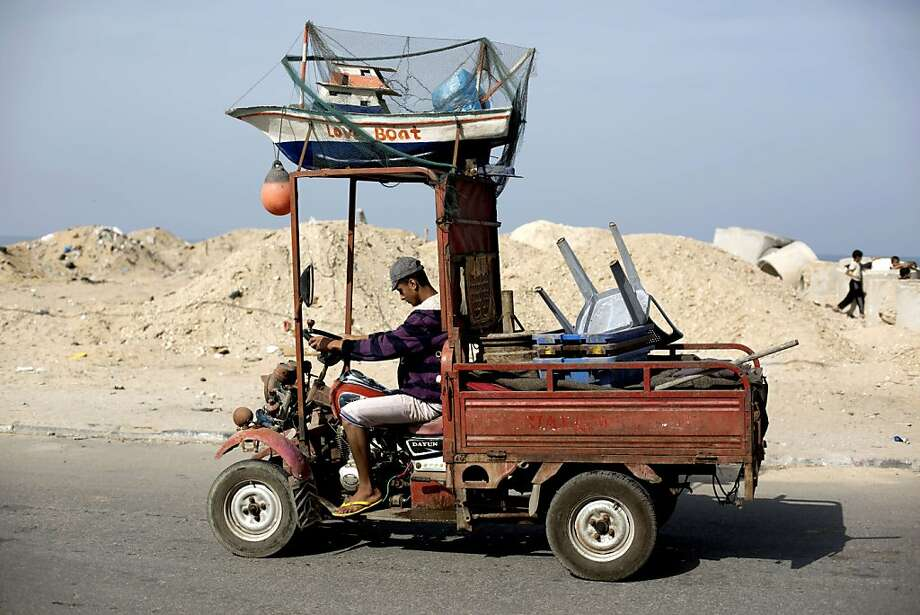 You know what they say about men with small trucks:They have tiny dinghies. (Nautically decorated vehicle in Gaza City.) Photo: Mohammed Abed, AFP/Getty Images