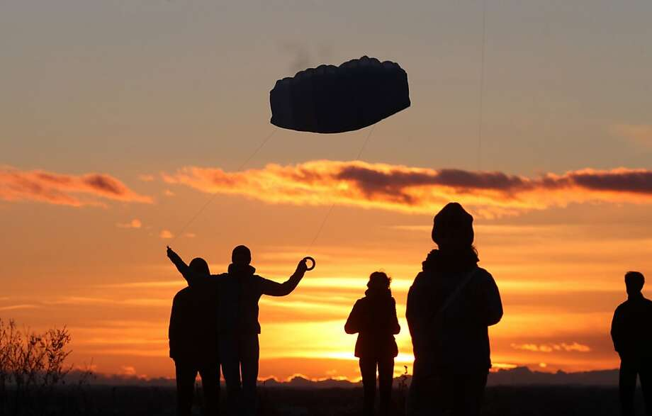 Go fly a ...Kite flyers launch their craft at sunset on Fockeberg Hill in Leipzig, Germany. Photo: Sebastian Willnow, Associated Press