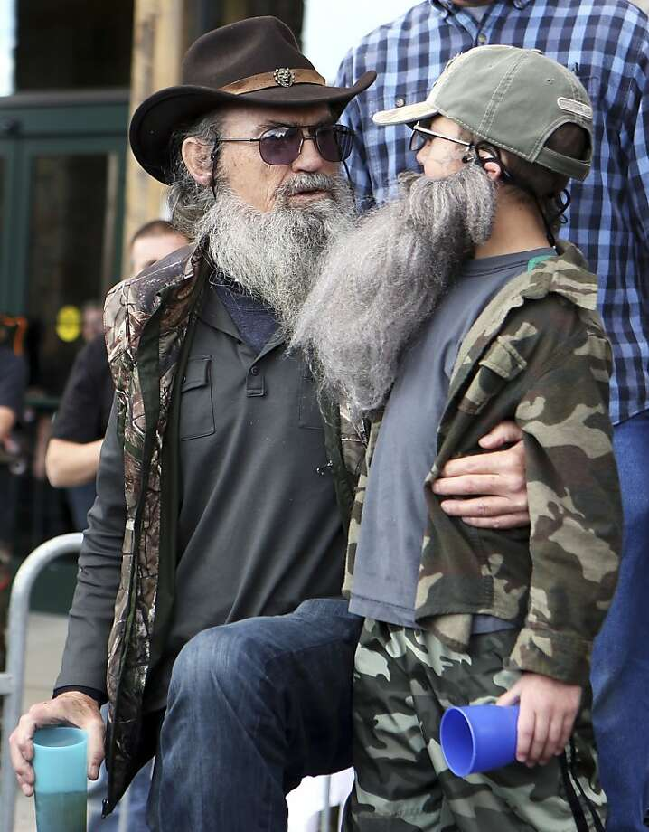 """You look just like me when I was 12:Si Robertson of A&E's """"Duck Dynasty"""" congratulates Callen Lay, who won his age group in a look-a-like contest at the opening of a new Field and Stream Store in   Crescent Springs, Ky. Photo: Cara Owsley, Associated Press"""