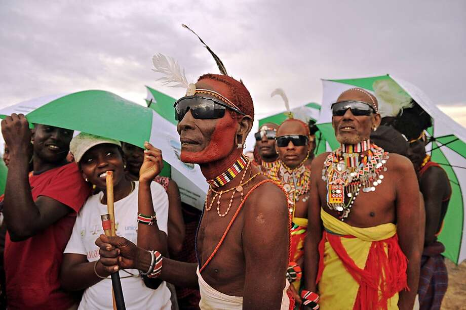 "Stylin' for the eclipse: Rendile tribesmen prepare to watch the ""hybrid"" eclipse at Sibiloi National Park in Turkana, Kenya. A hybrid 