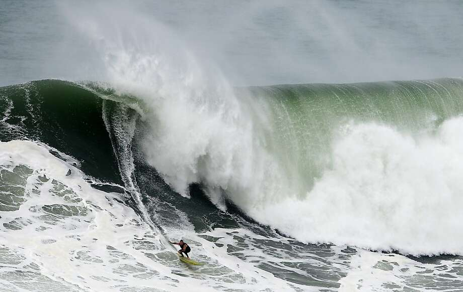 Compared to the skyscraper-tall wave ridden by Brazilian Carlos Burle last week (a potential record-breaker), this swell surfed by American Garrett McNamara at Nazare, Portugal, is a mere ripple. Photo: Francisco Leong, AFP/Getty Images