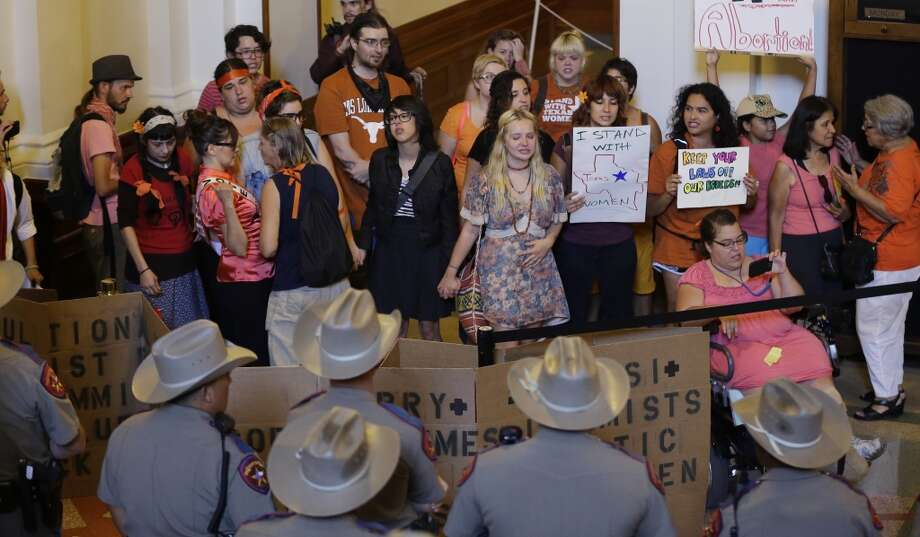 Opponents of HB 2, an abortion bill, yell outside the Texas House after the final vote, Wednesday, July 10, 2013, in Austin, Texas. The bill, which now goes to the Texas Senate,  would require doctors to have admitting privileges at nearby hospitals, only allow abortions in surgical centers, dictate when abortion pills are taken and ban abortions after 20 weeks. (AP Photo/Eric Gay) Photo: Associated Press