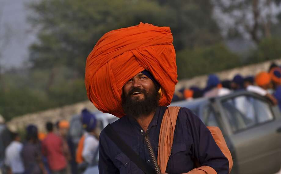 It takes a strong neck: A Nihang (traditional Sikh religious warrior) smiles under a turban big enough to hold a week's worth of laundry at the Fateh Divas celebration in Amritsar, India. Photo: Sanjeev Syal, Associated Press