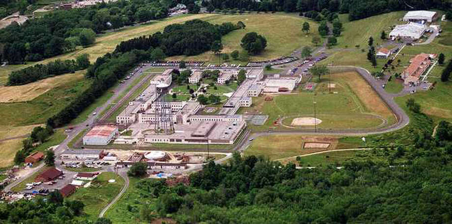 Federal Correctional Institution in Danbury, Conn. Following an outcry over the plan to move female prisoners from the only federal women's lockup in the Northeast, the Bureau of Prisons is now considering keeping some female prisoners housed at the Federal Corrections Institute in Danbury, officials said. Photo: File Photo/ David W. Harple, File Photo / The News-Times File Photo