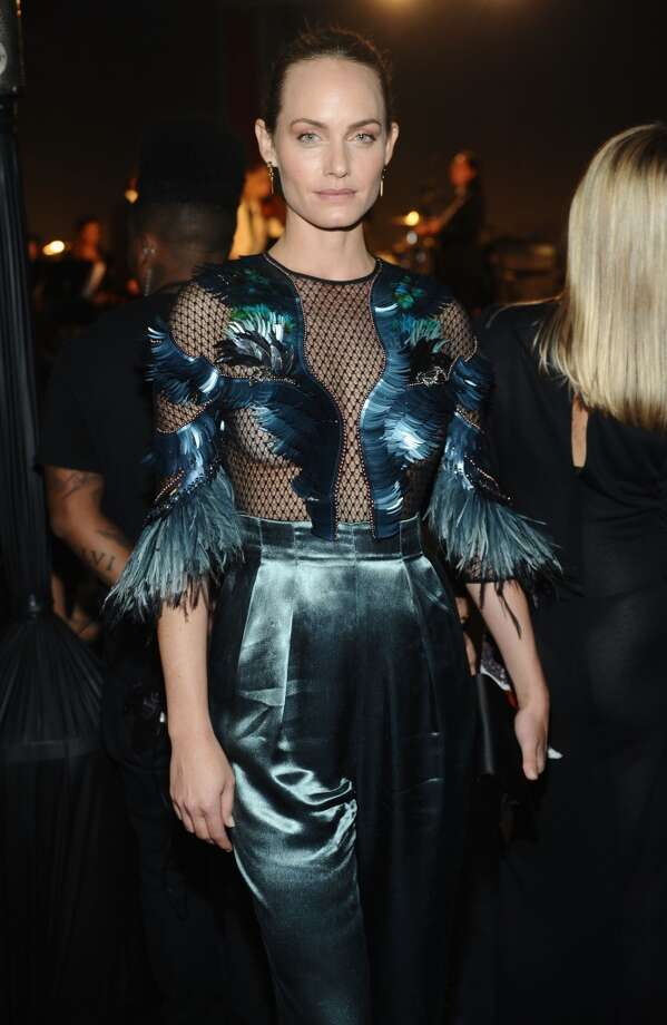 Actress Amber Valletta, wearing Gucci, attends the LACMA 2013 Art + Film Gala honoring Martin Scorsese and David Hockney presented by Gucci at LACMA on November 2, 2013 in Los Angeles, California. Photo: Stefanie Keenan, Getty Images For LACMA
