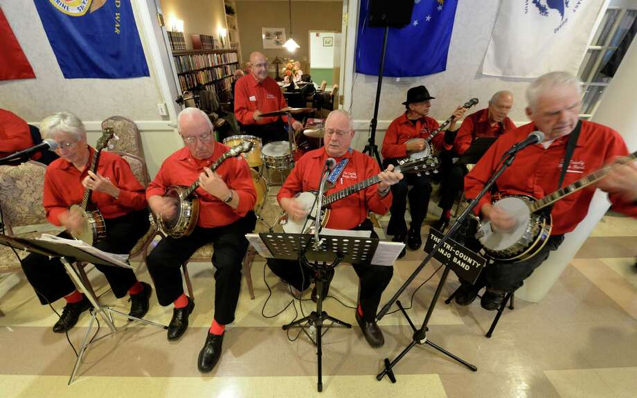 Members of the Tri-County Banjo Band play for veterans who gathered at the Colonie Senior Service Center Nov. 4, 2013, for their annual Veterans Luncheon sponsored by First Niagara in Colonie, N.Y.  (Skip Dickstein/Times Union) Photo: SKIP DICKSTEIN / 00024500A