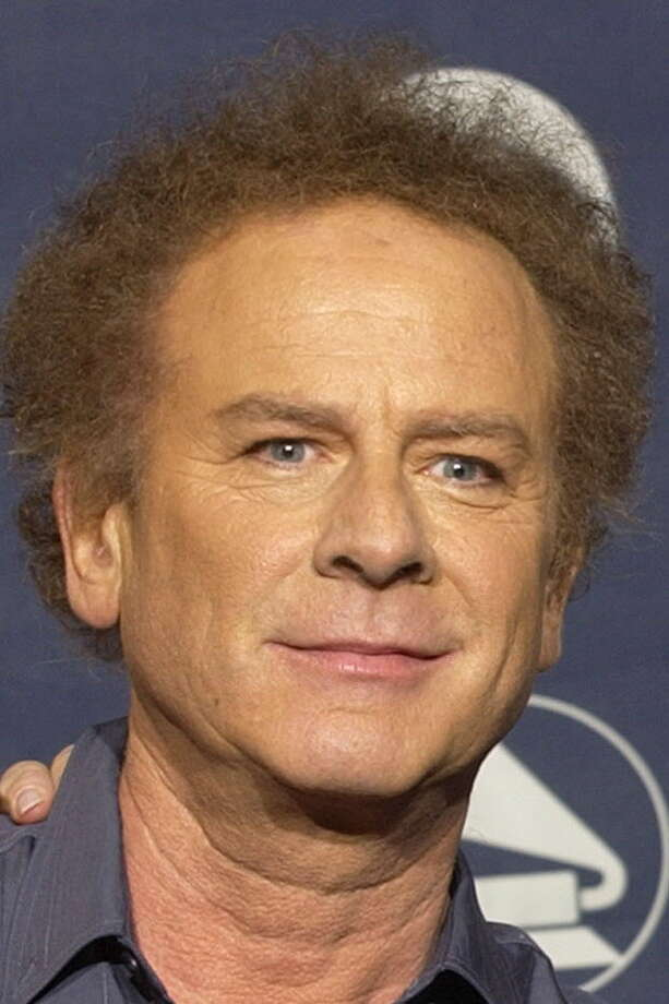 ** FILE ** Art Garfunkel is shown backstage at the 45th Annual Grammy Awards, Feb. 23, 2003, in New York.  Garfunkel was charged with marijuana possession after police pulled his limousine Saturday, Jan. 17, 2004 over for speeding in Hurley, New York, about 50 miles southwest of Albany, the Daily Freeman of Kingston reported. (AP Photo/Kathy Willens) Photo: KATHY WILLENS / AP