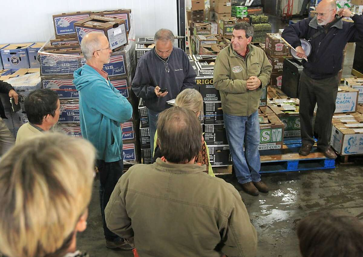 Jack Pizza, Owner of Washington Vegetable Company, second from right, takes questions from a group of farmers October 29, 2013 during a tour and discussion about wholesale food selling techniques and requirements at Washington Vegetable Company in San Francisco, Calif. Small farmers who typically only sell at farmer's markets are learning through a UC Davis Extension about how to become wholesalers.