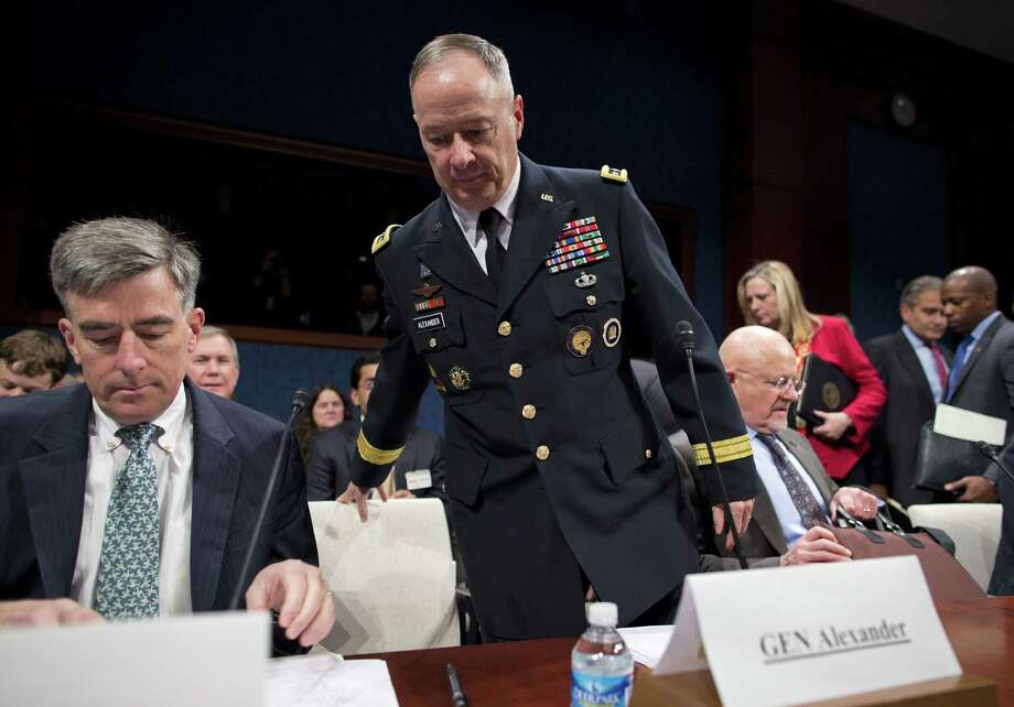 National Security Agency Director Gen. Keith Alexander sits down to testify  at a House Intelligence Committee hearing. Photo: Evan Vucci / Associated Press