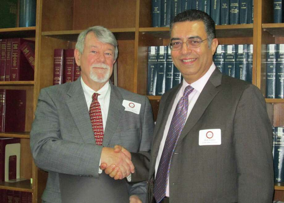 Paul E. Furrh Jr. presented the 2013 Pro Bono Award to Shah S. Ardalan of Lone Star College University Park. Photo: Provided By Lone Star College System