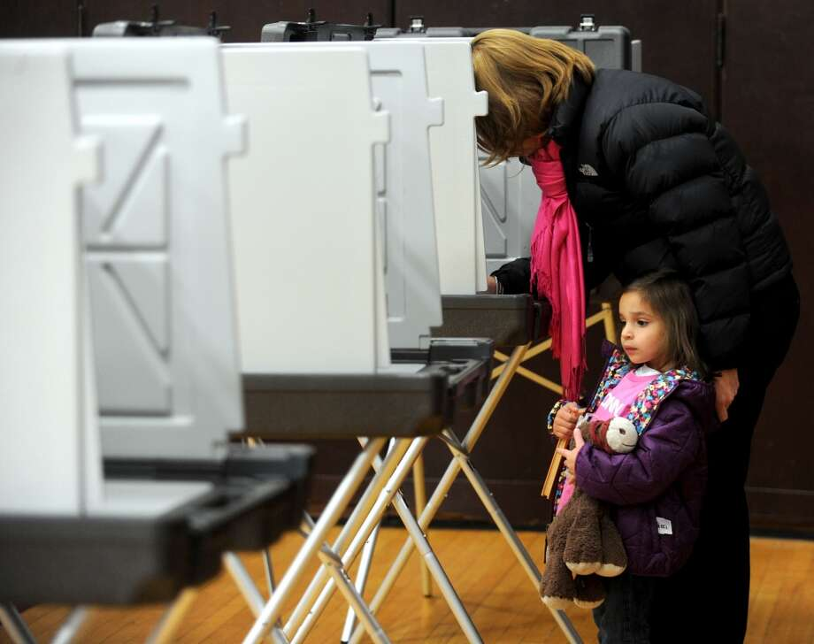 Election Day is, of course, held each year so people can vote, such as Alison Pellicci did in 2012 along with her daughter, Grace, at Dolan Middle School. But after you vote, you may be looking for something to do for the rest of the day. There are plenty of opportunities out there. Photo: Lindsay Niegelberg