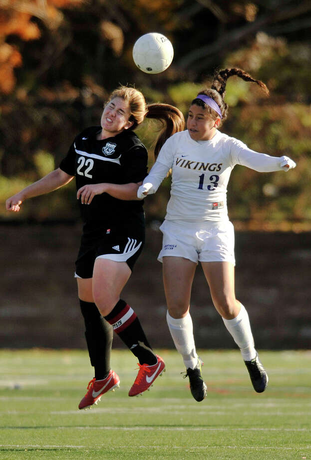 Trumbull's Nicole Schwartz and Westhill's Francesca McDonald compete for the head ball during their CIAC tournament first round game at Westhill High School in Stamford, Conn., on Monday, Nov. 4, 2013. Trumbull won, 4-0. Photo: Jason Rearick / Stamford Advocate