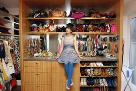 Susan Koger, editor of the fashion website ModCloth, poses for a portrait in her fabulous closet at her home in San Francisco, CA Tuesday September 3, 2013.
