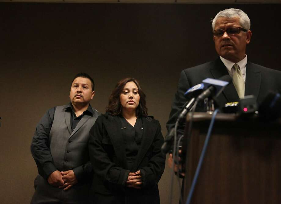 Andy Lopez Cruz's parents, Rodrigo Lopez (left) and Sujay Cruz, listen to attorney Arnoldo Casillas at a press conference. Photo: Lea Suzuki, The Chronicle