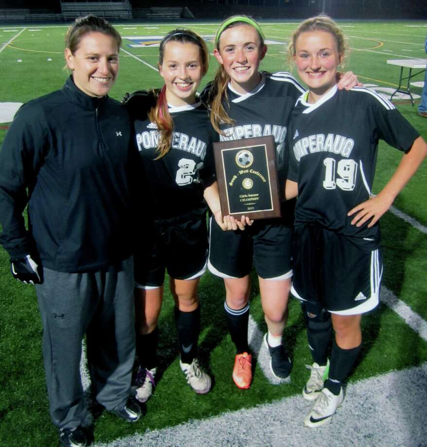 Coach Erin Tanucci and the Panther captains proudly display their gold title plaque after New Milford High School girls' soccer had suffered a 2-1 double-overtime defeat to Pomperaug in the South-West Conference championship match at Newtown High School. Nov. 1, 2013 Photo: Norm Cummings / The News-Times