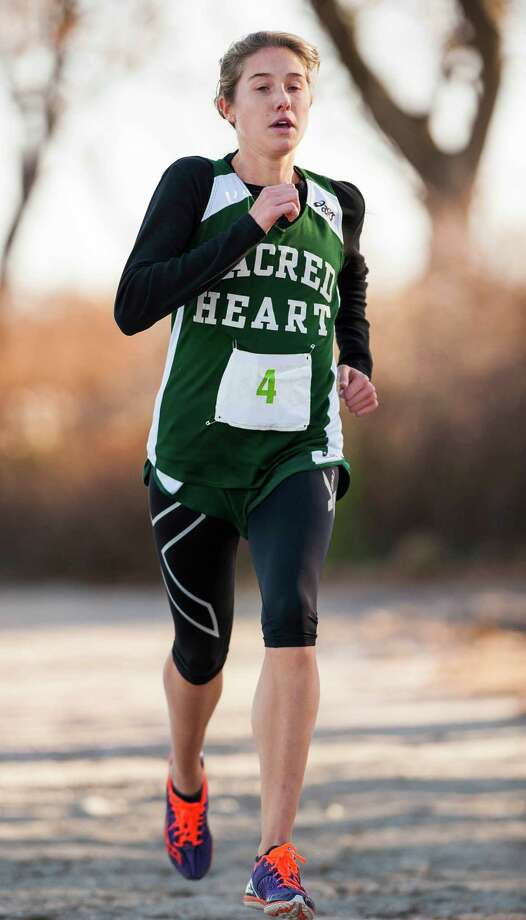 Emma Church, Convent of the Sacred Heart Academy, comes in third place (first place for her team) at the Fairchester Athletic Association girls cross country championship held at Greenwich Point, Greenwich, CT on Monday, November, 4th, 2013. Photo: Mark Conrad / Connecticut Post Freelance
