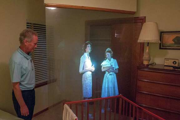 Kevin Kendro, archives coordinator for the city of Irving, demonstrates a projection technique called Pepper's Ghost in the bedroom used by Marina Oswald, at right, at the Ruth Paine House Museum in Irving.