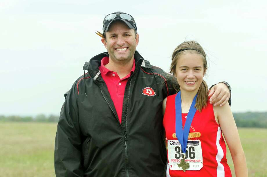 Coach Jeff Tesone stands with junior Emily Yoder after the Texas Association of Private and Parochial Schools State Cross Country Championships. Photo: Provided By Pope John XXIII High School / KF Yoder