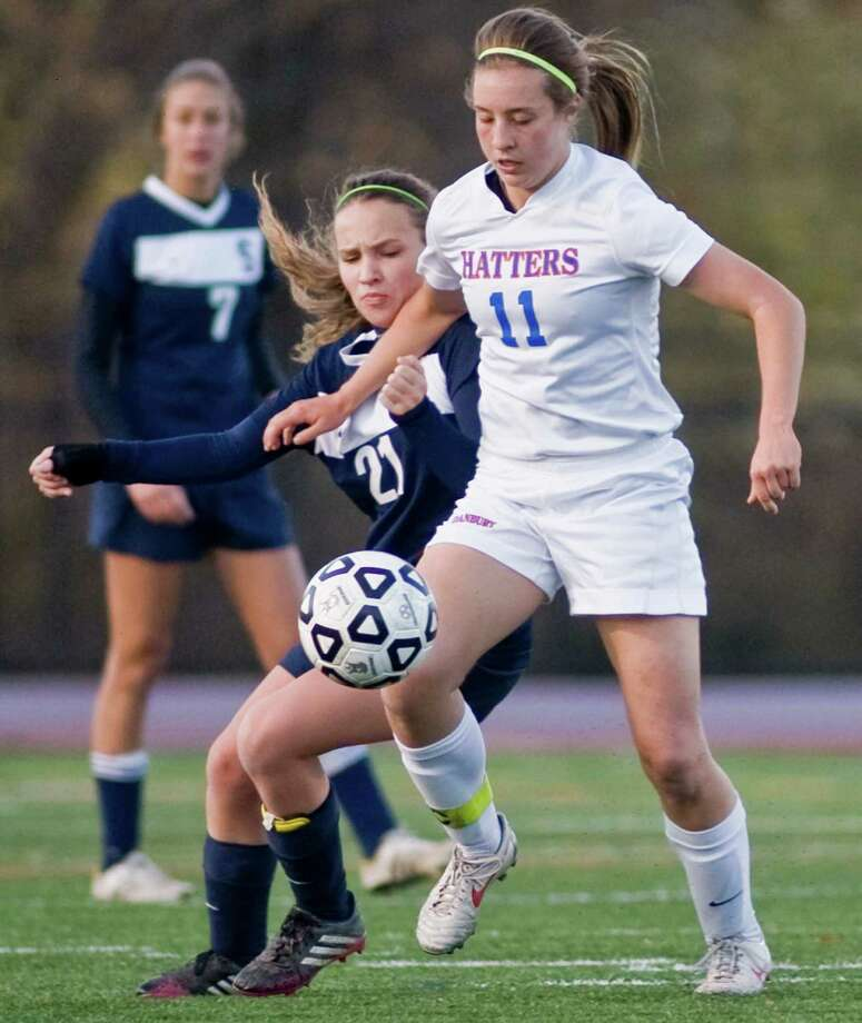 Staples High School's Adelaide Fowle tries to get under Danbury High School's Rachel Gartner in the Class LL state tournament game played at Danbury. Monday, Nov. 4, 2013 Photo: Scott Mullin / The News-Times Freelance