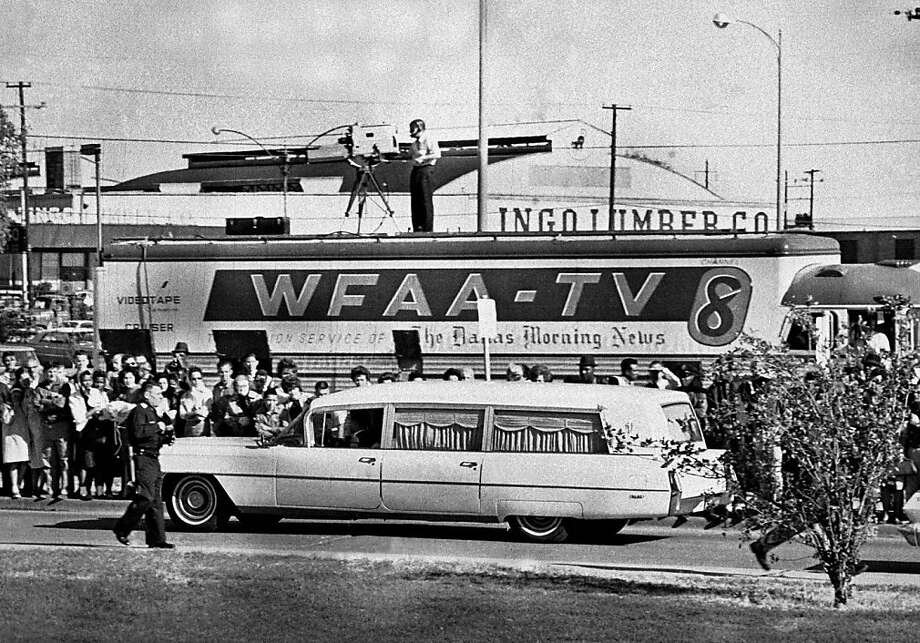 The hearse carrying the body of President John F. Kennedy passes a television news truck in Dallas on Nov. 22, 1963. Photo: Uncredited, Associated Press