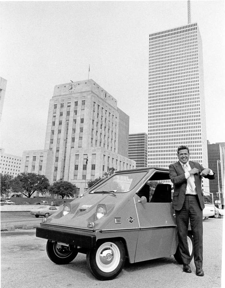 In 1975, Houston City Controller Leonel Castillo showed off an electric car he leased. Castillo said it was cheaper to operate than regular cars. He used it for short-trip errands. Photo: Bill Clough, HC Staff / Houston Chronicle