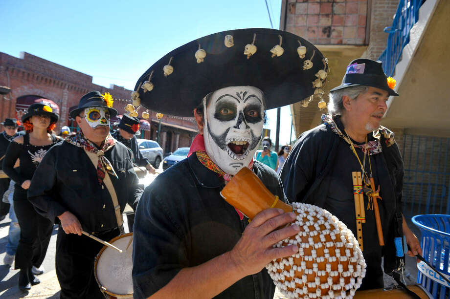 Members of Los Olvidados march through Market Square during Día de los Muertos festivities last weekend. The colorful events honoring the dearly departed occurred throughout much of the South Side and West Side. Photo: Photos By Robin Jerstad / For The Express-News