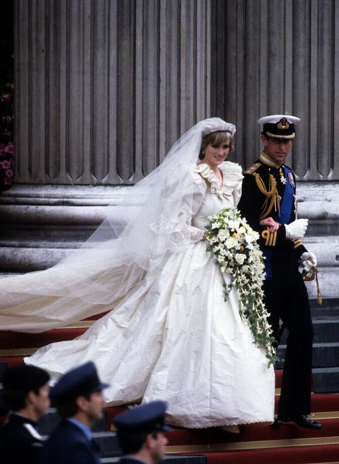 Diana, Princess of Wales, wearing an Emanuel wedding dress, leaves St. Paul's Cathedral with Prince Charles, Prince of Wales following their wedding on 29 July, 1981 in London, England. Photo: Anwar Hussein, Getty Images