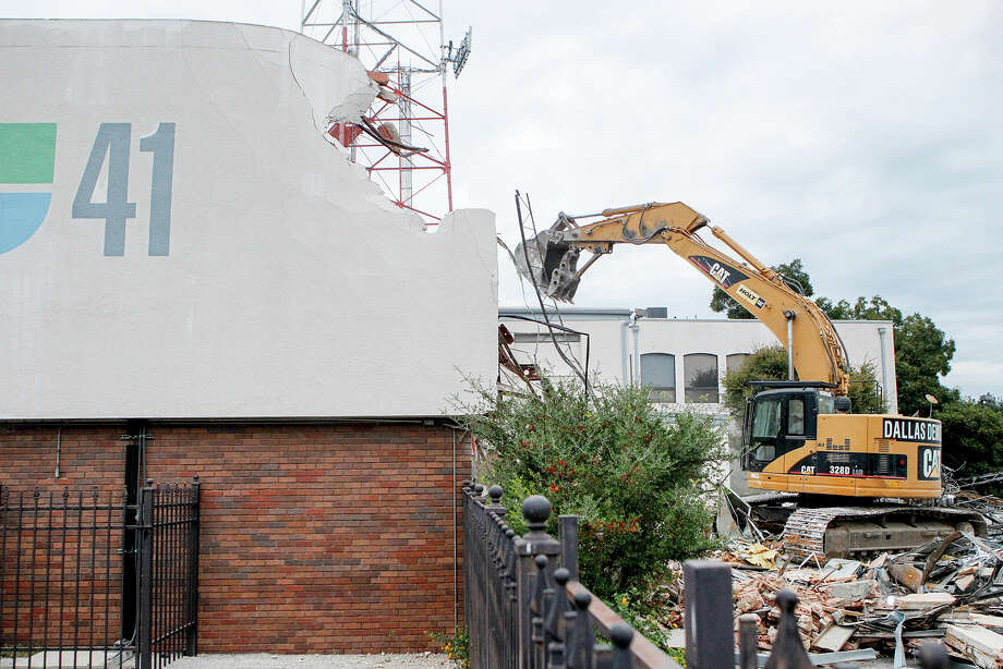 Demolition of the KWEX 41/Univision building at 411 E. Cesar E. Chavez Blvd began on Monday, Nov. 4, 2013.  The building is being demolished to make room for a 350-room apartment development on the prime area of the River Walk.  MARVIN PFEIFFER/ mpfeiffer@express-news.net Photo: MARVIN PFEIFFER, Marvin Pfeiffer/ Express-News / Express-News 2013