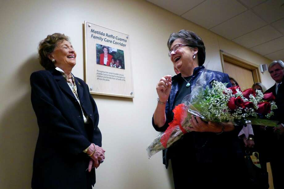 """Matilda Raffa Cuomo, left, and Linda Kurtz, share a laugh as Kurtz presents Mrs. Cuomo with some flowers at Albany Medical Center Monday, Nov. 4, 2013. in Albany, N.Y.  Albany Medical's Neonatal Intensive Care Unit was named in honor of Mrs. Cuomo because of her advocacy for pre-natal care, breastfeeding and children's nutrition.  Kurtz, who was at one time the regional director of the Office of Children and Family Services, worked with Mrs. Cuomo when her husband was governor.  """"She was the boss and became my friend,"""" Kurtz said of knowing Mrs. Cuomo over the years.   (Paul Buckowski / Times Union) Photo: Paul Buckowski / 00024499A"""