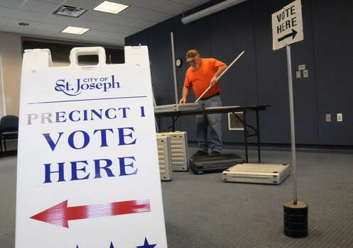 Jim Frazee, with the St. Joseph City Streets and Sanitation Department, helps set up voting booths Monday, Nov. 4, 2013 as the city prepares for election day at the Maud Preston Palenske Memorial Library in St. Joseph, Mich. (AP Photo/The Herald-Palladium, Don Campbell) Photo: DON CAMPBELL, Associated Press