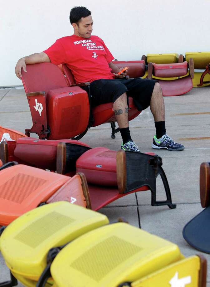 Steve Arce sits in an Astrodome seats as he waits outside Reliant Center to load the seats Saturday, Nov. 2, 2013, in Houston. ( Melissa Phillip / Houston Chronicle ) Photo: Melissa Phillip, Staff / © 2013  Houston Chronicle