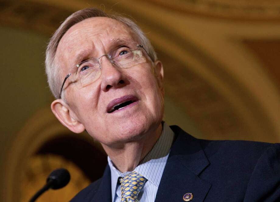 FILE - In this Oct. 29, 2013 file photo, Senate Majority Leader Harry Reid, D-Nev. speaks on Capitol Hill in Washington. The Senate prepared to push major gay rights legislation past a first, big hurdle Monday as Democrats and a handful of Republicans united behind a bill to prohibit workplace discrimination against gay, bisexual and transgender Americans. (AP Photo/J. Scott Applewhite, File ) ORG XMIT: WX106 Photo: J. Scott Applewhite / AP