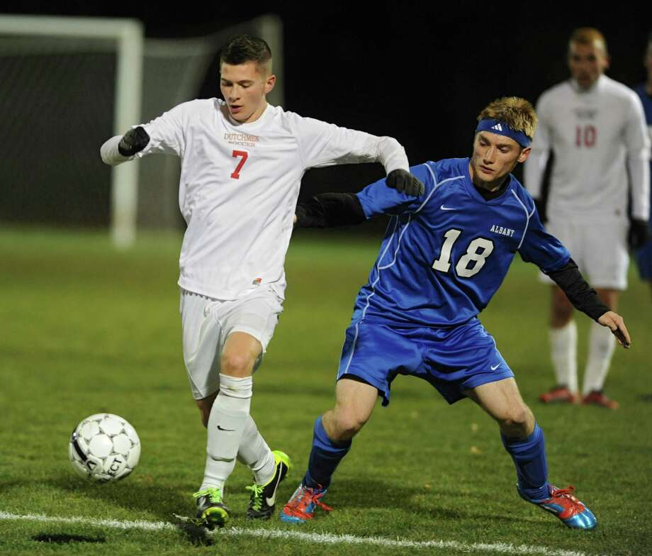 Guilderland's Keagan Ciaschetti, left, and Albany's Ben Wells battle for the ball during the Section II Class AA boys' soccer final on Monday, Nov. 4, 2013 in Colonie, N.Y.  (Lori Van Buren / Times Union) Photo: Lori Van Buren / 00024503A