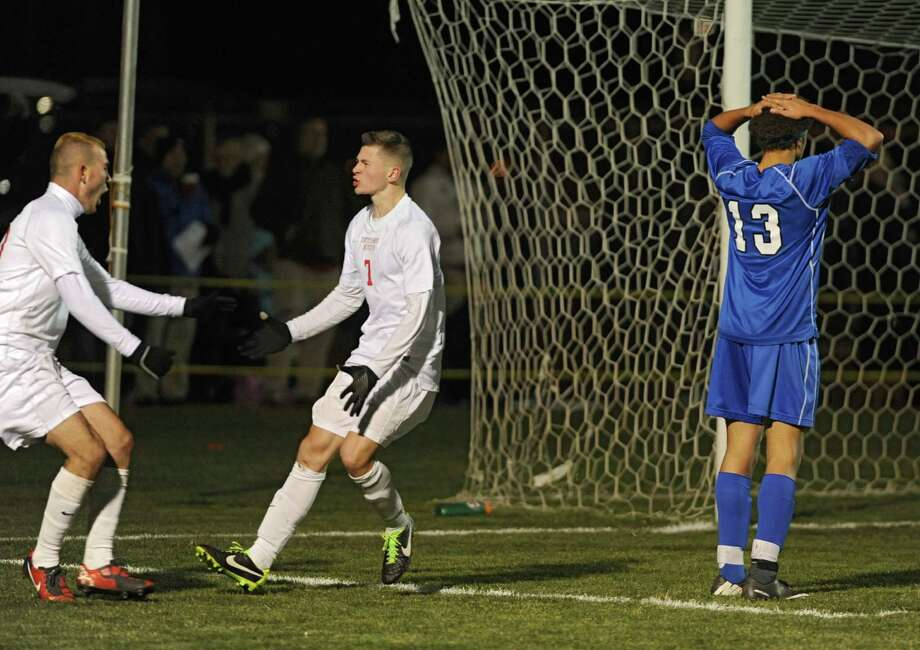 Guilderland's Kledis Capollari, left, and Keagan Ciaschetti celebrate after Capollari assisted Ciascetti with a goal in the second half of the Section II Class AA boys' soccer final on Monday, Nov. 4, 2013 in Colonie, N.Y.  (Lori Van Buren / Times Union) Photo: Lori Van Buren / 00024503A
