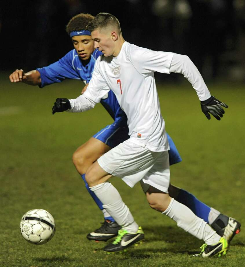 Albany's Jaheem Lawitz, left, and Guilderland's Keagan Ciaschetti battle for the ball during the Section II Class AA boys' soccer final on Monday, Nov. 4, 2013 in Colonie, N.Y.  (Lori Van Buren / Times Union) Photo: Lori Van Buren / 00024503A