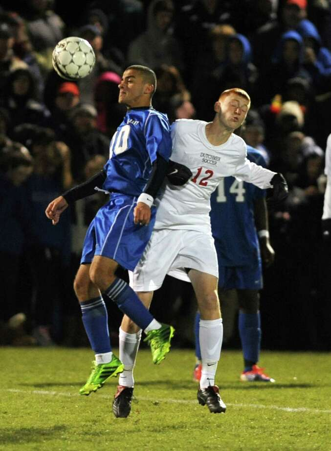 Albany's Ali Alalkawi, left, and Guilderland's Chris Sour battle to head the ball during the Section II Class AA boys' soccer final on Monday, Nov. 4, 2013 in Colonie, N.Y.  (Lori Van Buren / Times Union) Photo: Lori Van Buren / 00024503A