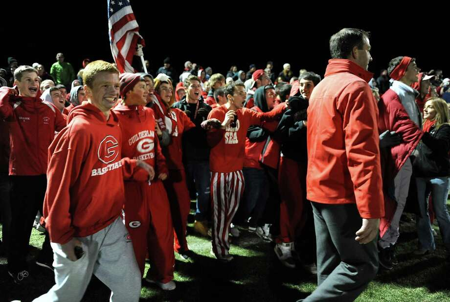 Guilderland fans get ready to run on the field to celebrate a win against Albany during the Section II Class AA boys' soccer final on Monday, Nov. 4, 2013 in Colonie, N.Y.  (Lori Van Buren / Times Union) Photo: Lori Van Buren / 00024503A