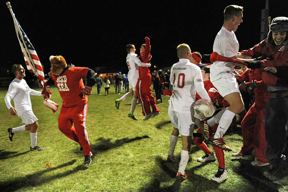 Guilderland celebrates a win against Albany at the end of the Section II Class AA boys' soccer final on Monday, Nov. 4, 2013 in Colonie, N.Y.  (Lori Van Buren / Times Union) Photo: Lori Van Buren / 00024503A