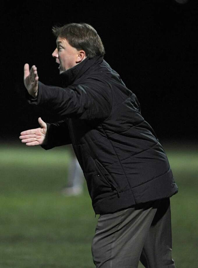 Guilderland coach Mike Kinnally hells to his players during the Section II Class AA boys' soccer final against Albany on Monday, Nov. 4, 2013 in Colonie, N.Y.  (Lori Van Buren / Times Union) Photo: Lori Van Buren / 00024503A
