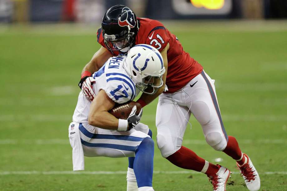 Houston Texans free safety Shiloh Keo (31) goes after Indianapolis Colts quarterback Andrew Luck (12) during the first quarter of an NFL football game, Sunday, Nov. 3, 2013, in Houston. (AP Photo/David J. Phillip) Photo: Associated Press / AP