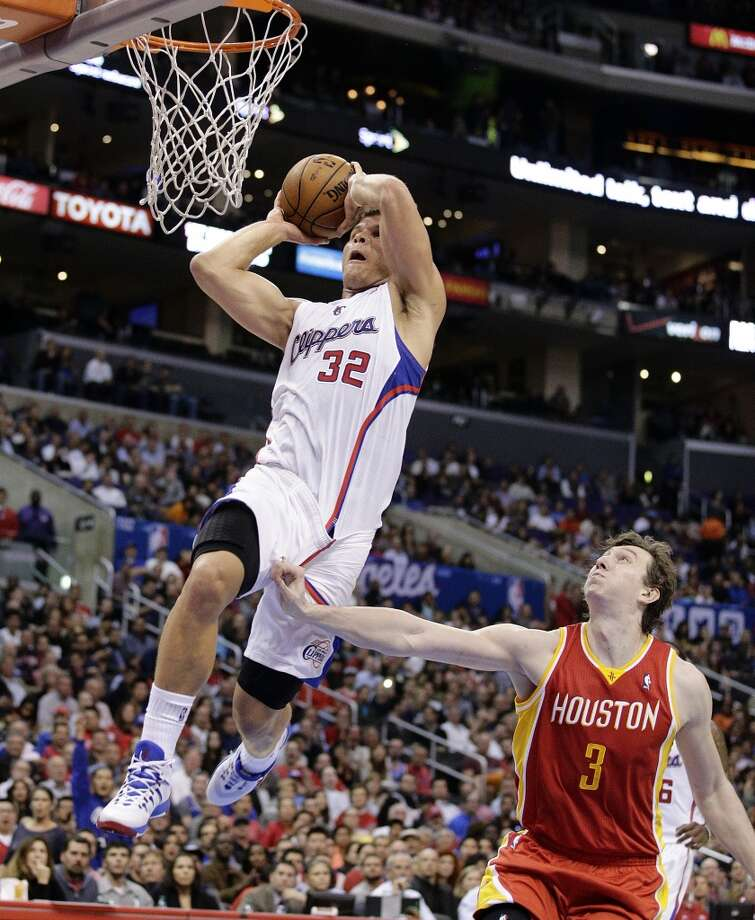 Nov. 4: Clippers 137, Rockets 118   Omer Asik of the Rockets watches as Clippers power forward Blake Griffin rises for a dunk. Photo: Jae C. Hong, Associated Press