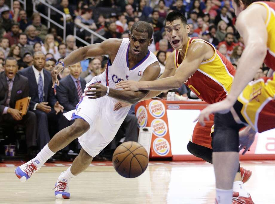 Rockets point guard Jeremy Lin battles for possession with Chris Paul of the Clippers. Photo: Jae C. Hong, Associated Press