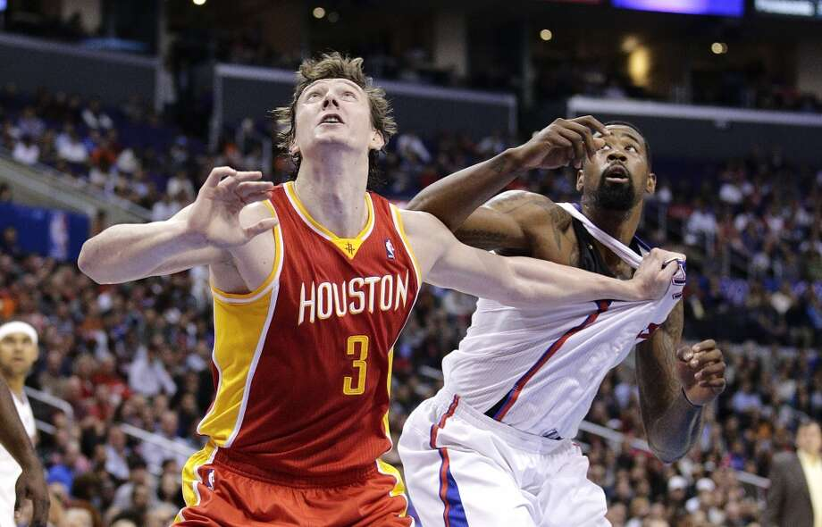 Omer Asik of the Rockets jockeys for position with Clippers center DeAndre Jordan. Photo: Jae C. Hong, Associated Press