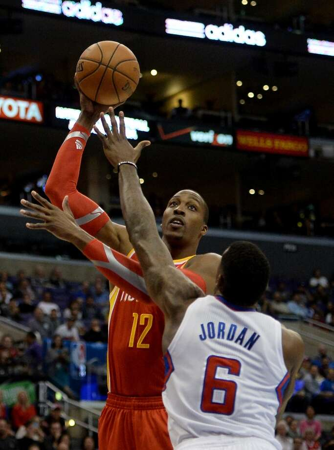 Rockets center Dwight Howard attempts a shot over DeAndre Jordan of the Clippers. Photo: Harry How, Getty Images
