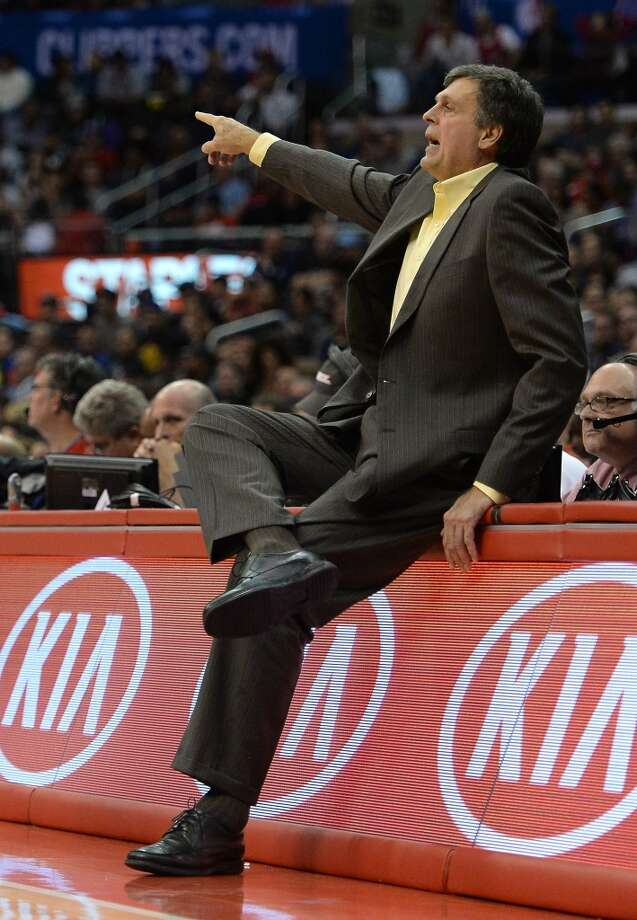 Rockets coach Kevin McHale watches as his team plays the Clippers. Photo: Harry How, Getty Images