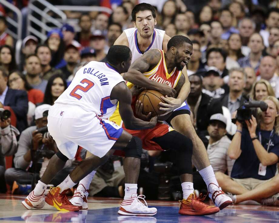 Rockets guard Aaron Brooks is harassed by two Clippers defenders. Photo: Jae C. Hong, Associated Press